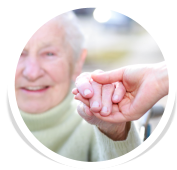 old woman holding the hand of the caregiver